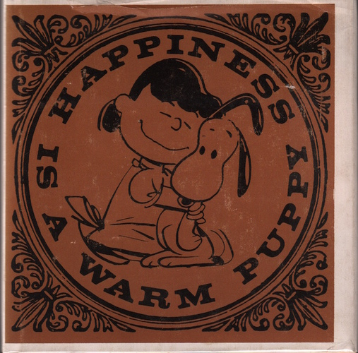 SCHULZ, Charles M.Happiness is a Warm Puppy.
